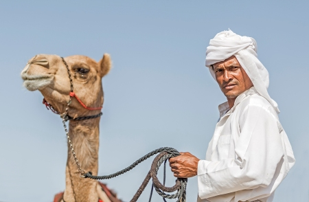 Men and camel